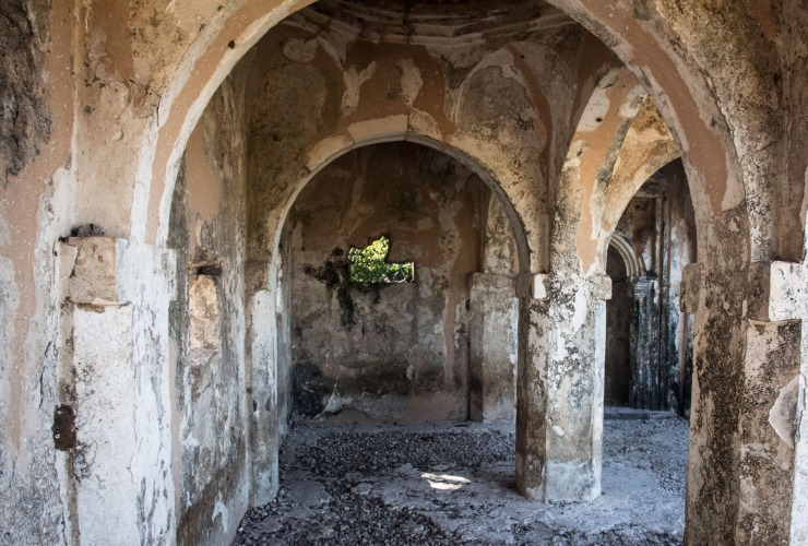 The substantial standing ruins, built of coral and lime mortar, include the Great Mosque constructed in the 11th century and considerably enlarged in the 13th century, and roofed entirely with domes and vaults, some decorated with embedded Chinese porcelain.